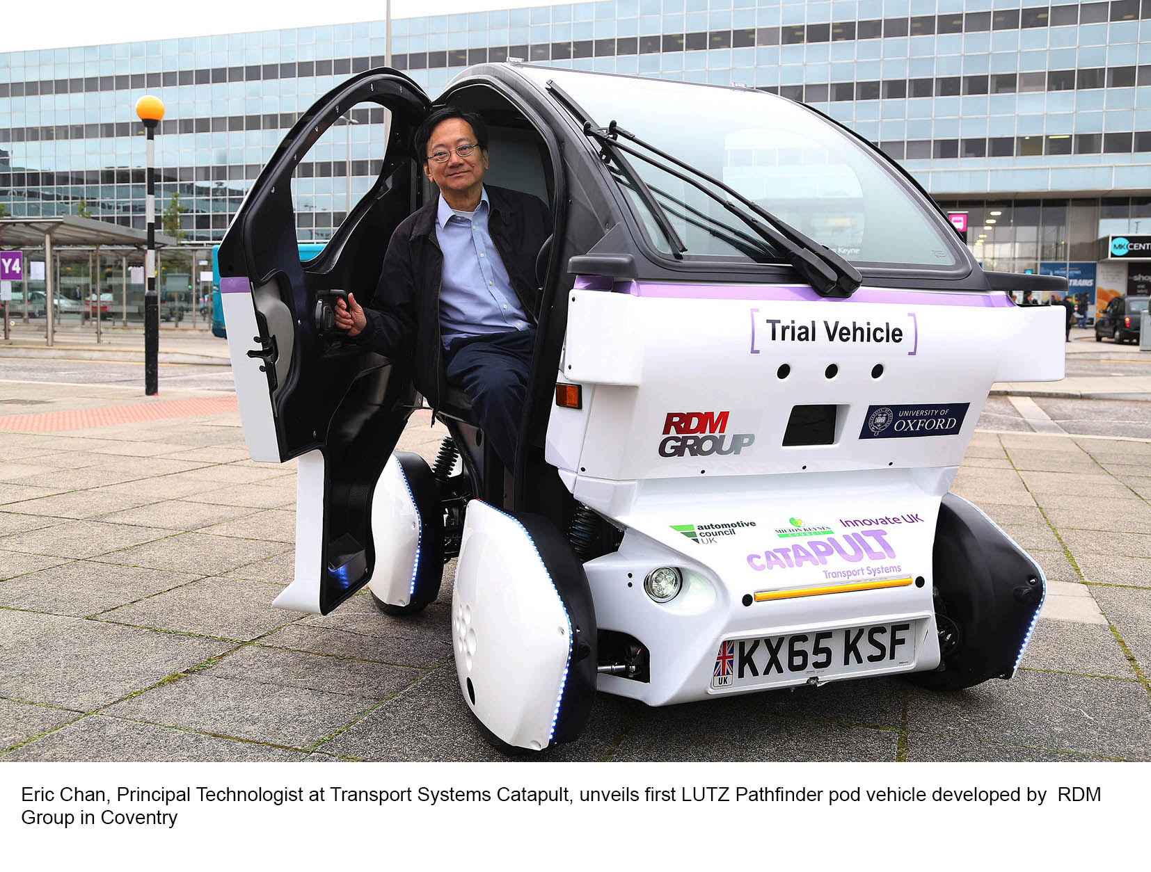 EDITORIAL USE ONLY Eric Chan, Principal Technologist Transport Systems Catapult, unveils Catapult's first LUTZ Pathfinder pod vehicle to commuters outside Milton Keynes Central train station, as part of a project trialling self-driving technology in pedestrianised areas. PRESS ASSOCIATION Photo. Picture date: Tuesday September 15, 2015. Following the presentation, the pod will be delivered to Oxford University's Mobile Robotics Group to begin the installation of the vehicle's autonomous control system before undergoing a series of calibration tests to become the first fully automated vehicles on public pedestrianised areas in the UK. Photo credit should read: Geoff Caddick/PA Wire